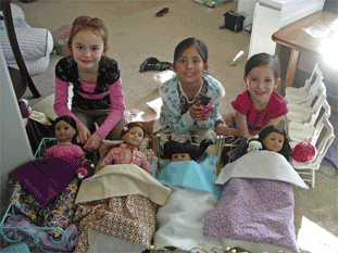 All the dolls with their beds