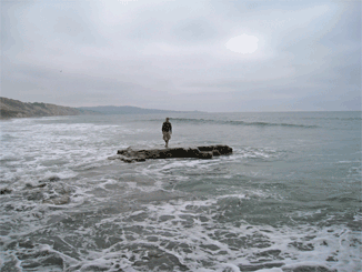 Jason hangs on the rocks