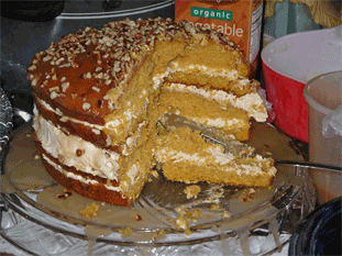 The yummy 4-layer pumpkin cake with caramel sauce I made.