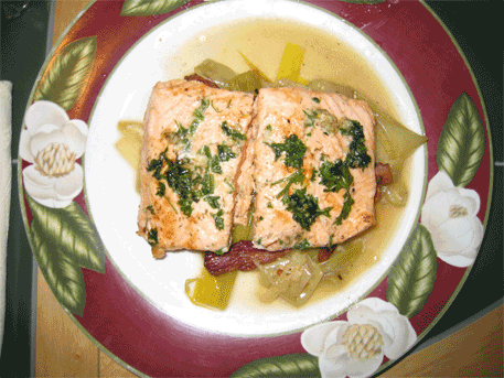 One of my recent creations: sauteed salmon served over a bed of leeks and bacon with a creamy white wine sauce