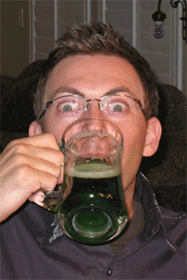 Jas guzzling his green brew.