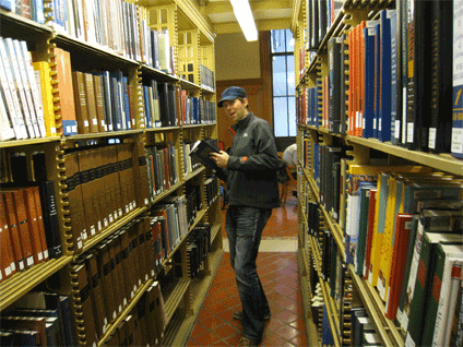 Jason entered a ropped off section of the library so Jeremy could take a picture of him reenacting the first scene in Ghostbusters.