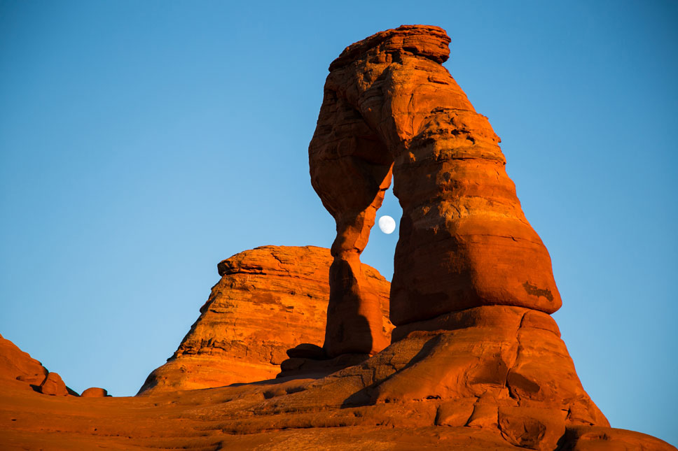 The nearly-full moon nestled itself inside Delicate Arch for a minute or two.