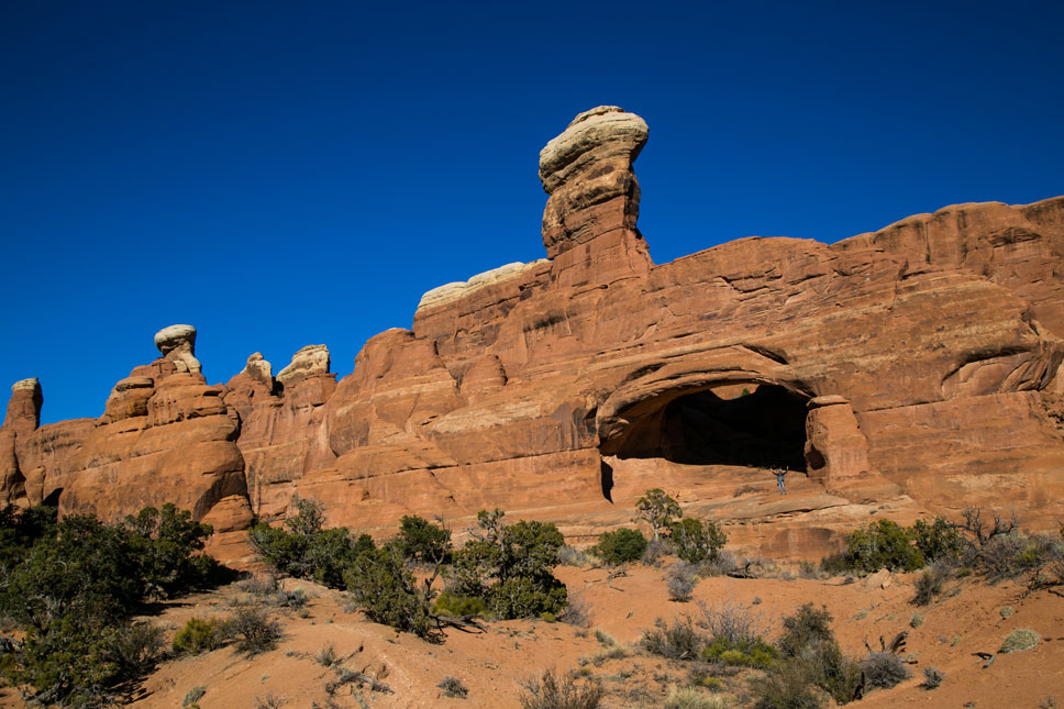 It takes a little effort to reach Tower Arch's sculpted sandstone and knobby chimney.