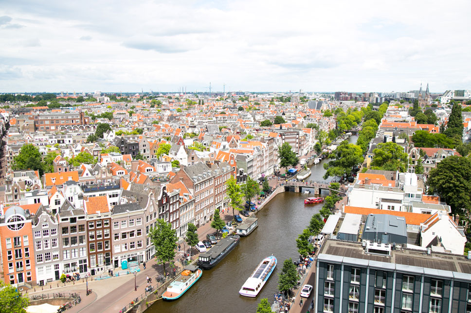 From the Westerkerk's tower, the tallest in Amsterdam, miles of colorful rooftops and canal grids are visible.