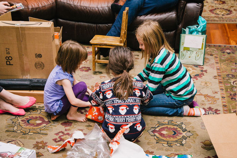 Jason masked the kids' present under many layers of boxes and giftwrap, which resulted in an intense group effort fueled by impatience and curiosity.