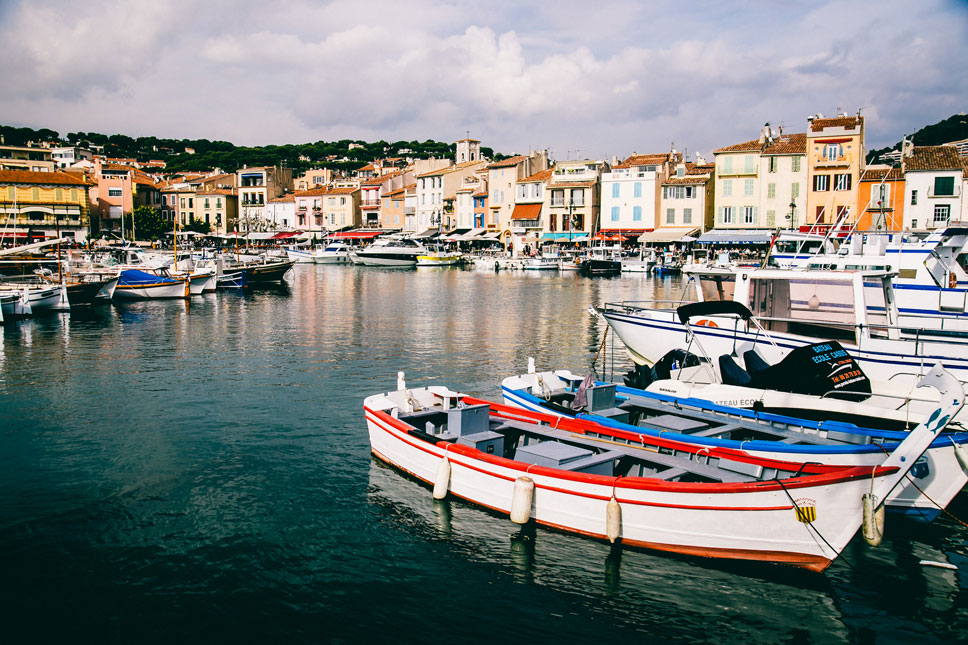 In Cassis, brightly-colored boats bobbed just beyond colorful cafes.